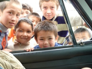 Young boys living in no-mans land on the Kyrgyzstan-Uzbekistan border